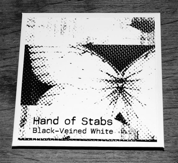 Hand of Stabs-Black-Veined White-Dawn Edition-front of cover-A Year In The Country.jpg